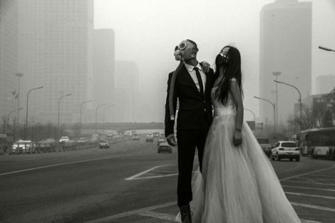 A Beijing couple wears gas masks in their wedding pictures, making a point about the city's smog problem.