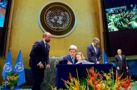 secretary_kerry_holds_granddaughter_dobbs-higginson_on_lap_while_signing_cop21_climate_change_agreement_at_un_general_assembly_hall_in_new_york_26512345421